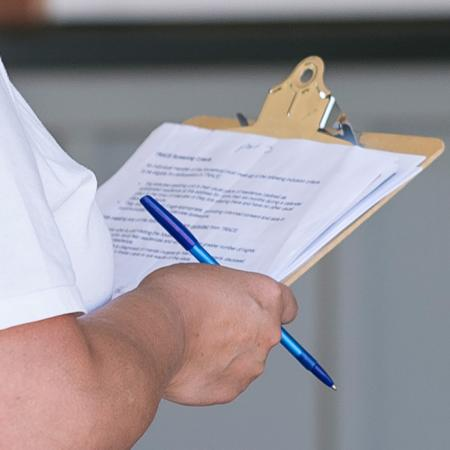Person holding clipboard for TRACE testing.